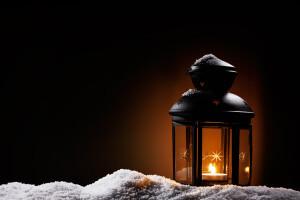 lantern in the night on snow